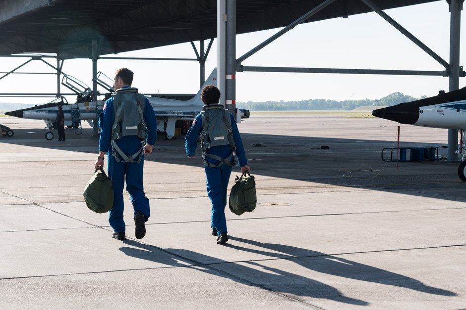 Astronaut candidates, Joshua Kutryk and Jessica Watkins, head out for a T-38 test flight