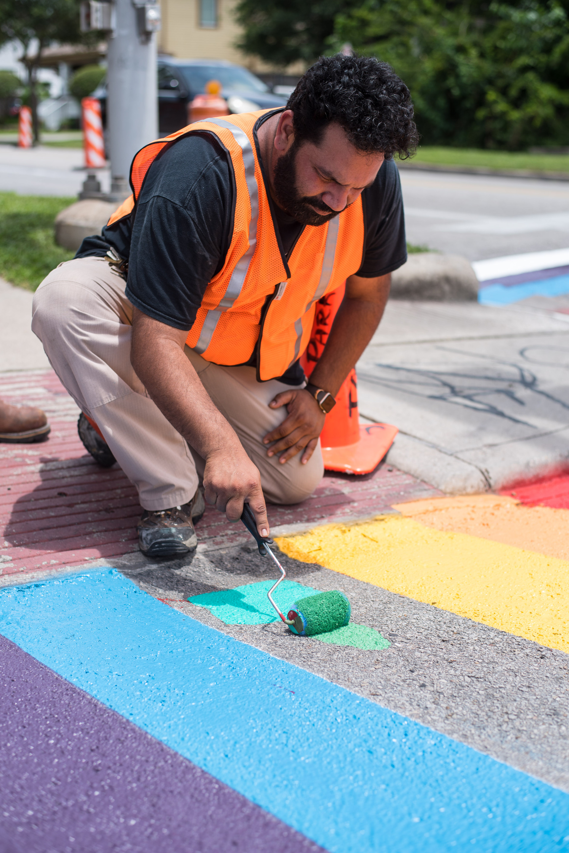 Up Art Studio painting Houston's first pride crosswalk is a memorial for Alex Hill who was killed in a hit and run at this intersection. It simultaneously serves as a symbol for diversity and traffic safety.