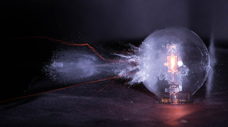 Highspeed photograph of a bullet striking a lit light bulb. After the bullet is fired it passes two IR sensors, connected to an Arduino Uno. The system calculates the velocity of the bullet and a delay is added to capture the bullet after it hits the light bulb by firing a high speed flash. This photo was made in collaboration with Shauna Fowler, Jordan Salkin, and Matthew Cancel.
