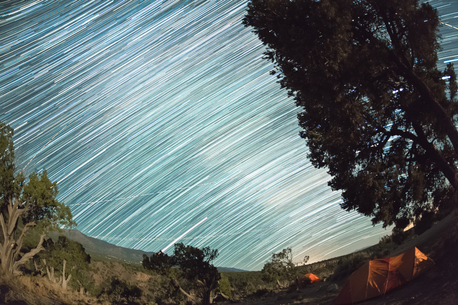 Star trail image of the apparent motion of the stars in the sky over our campsite in the Rí­o Grande del Norte National Monument.