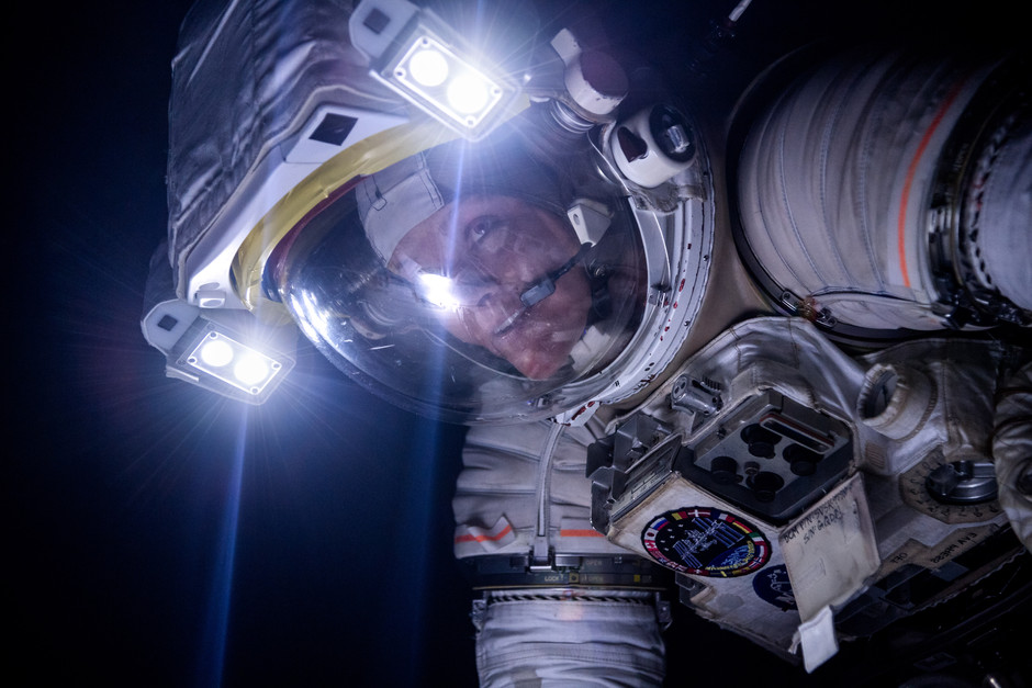 Astronaut Anne McCLlain training in the Active Response Gravity Offload System (ARGOS) during a lights out night time microgravity simulation.