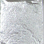 Silver nail art nuggeting foil inside it's plastic case designed for nail art designs.