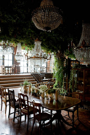 The ceiling was adorned with hanging plants to give the antique space an enchanted feel.