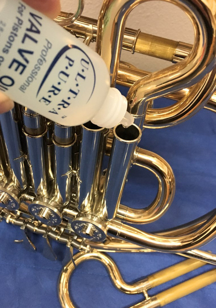 French horn with rotor oil, valve oil