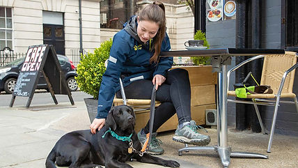 skye-and-her-trainer-at-an-outdoor-cafe.