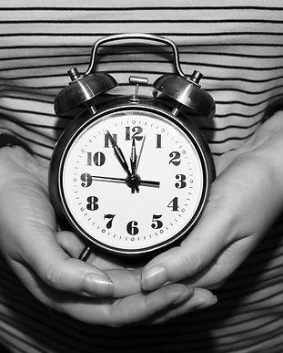 alarm clock in female hands_.jpg