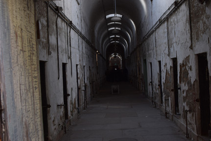 Eastern State Penitentiary is a miserable place of long hallways lined by tiny holes for doorways stoppered with iron-bound wooden slabs.