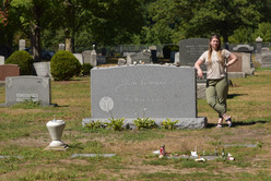 """For more than 5 decades Jack's grave was marked only by a small stone with """"John"""" as his name, and his childhood nickname, """"Ti Jean"""" above it.  In 2014 he received a headstone befitting his stature, with his signature and quote, """"The Road is Life."""""""