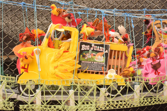 A small group of valiant chickens had escaped from broken cages off the back of a chicken truck in the middle of rush hour.