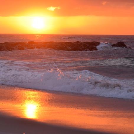 Waves Crashing on the Beach at Dawn