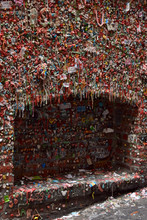 In an alley out back she found the Seattle Gum Wall slick with saliva and the Seattle rain.