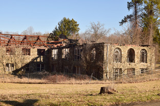 What now remains is the husks of stone dormitories, floors collapsing, and roofs lost to arson.