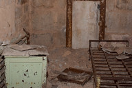 Each prisoner had a stool, a metal-framed bed, and about enough room to stand upright.