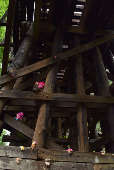Trolls climbed bravely to the top of the ancient structure.