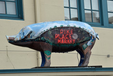 Pike Place is famous for thrown fish, a coffee flavor, and a concrete pig that accepts donations.