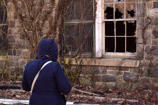 Indy-Anna heard ghosts whispering around her walking those sad grounds past broken windows, burned buildings, and boarded doors.