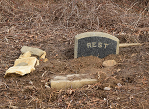 In the years of neglect, headstones have toppled and broken, and graves have begun to cave in.