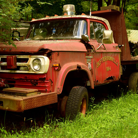 Vintage Firetruck at the Edge of a Forest