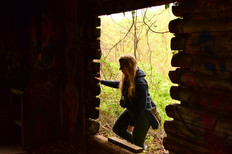 Indy Anna poked her head inside the decayed structures.