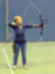 Lydia shooting with recurve