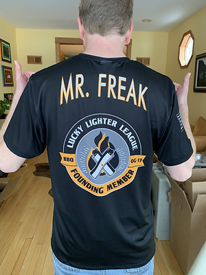 Mr. Freak wearing Lucky Lighter League founding member shirt