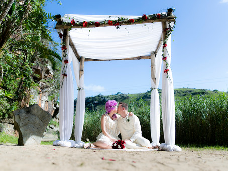 Tropical beach wedding with a Marie Antoinette bride and horses