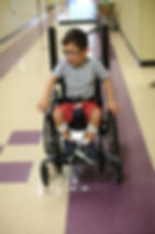 Student in a wheelchair in the hallway