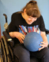 Client Emily playing with a ball