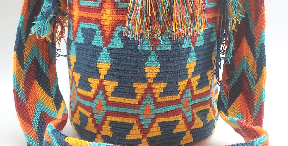 Handwoven Bucket Boho Wayuu Bag In Repetitive Bold Patterns In Red Blue Teal Orange And Yellow Has Pom Pom Cinch Closure