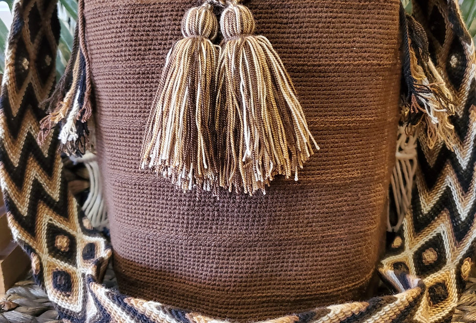 Handwoven Bucket Boho Wayuu Bag Has Solid Brown Body and Diamond Zig Zag Shoulder Strap With Black Brown And Cream Colors