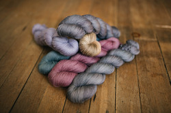 berry colored skeins of yarn