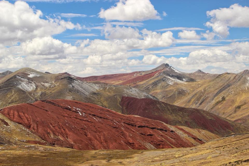You should visit the Palccoyo Rainbow Mountains because it is a pleasant and beautiful walk in the valley