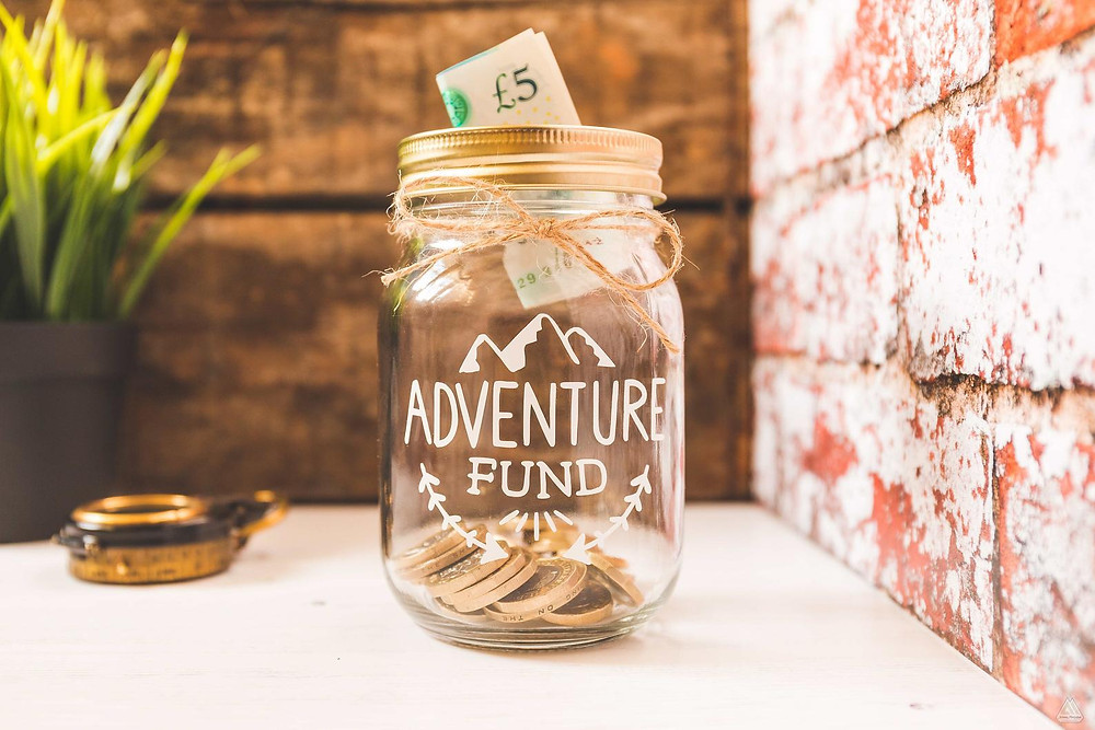 Fund jar to save money for your next budget trip
