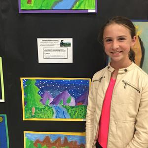 Burton Valley 5th grader Kelly Kilpatrick poses with her landscape portrait.