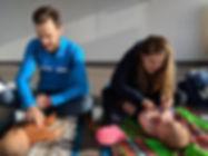 Parents learning infant massage techniques