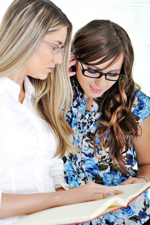 girl-and-woman-mentor-reading-together-a
