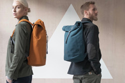 A couple with colourful backpacks