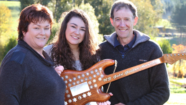 New Zealand Gold Guitar winner Jenny Mitchell,18, at home with her parents Julie and Ron near Gore.