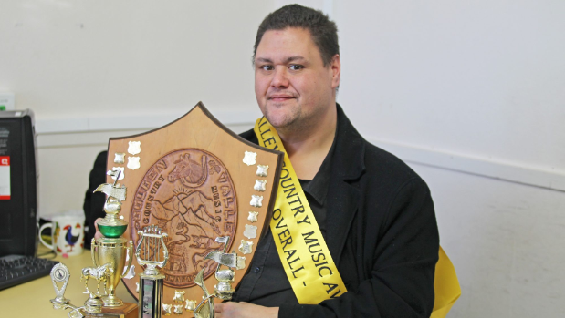 einan Ngapo with his multiple Golden Valley Country Music Award trophies.