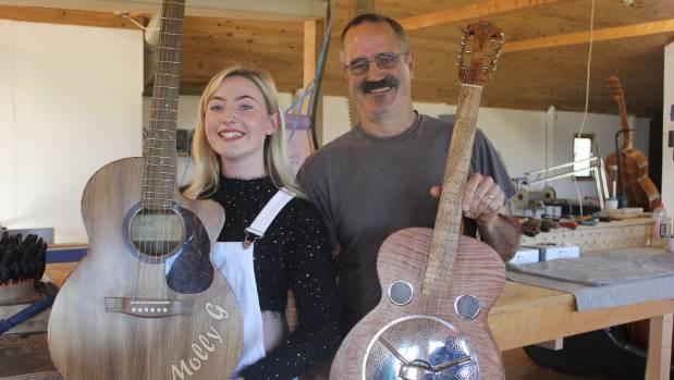 Molly G Usmar with Johan van der Gaag. Molly has made three guitars with Johan.