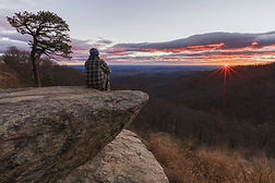 Sunrise man on rock