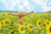 Woman in field of sunflowers.jpg