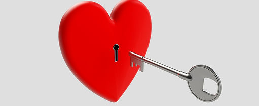 Red heart shaped padlock and key