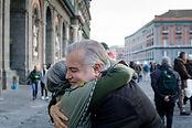 Older man hugging older woman