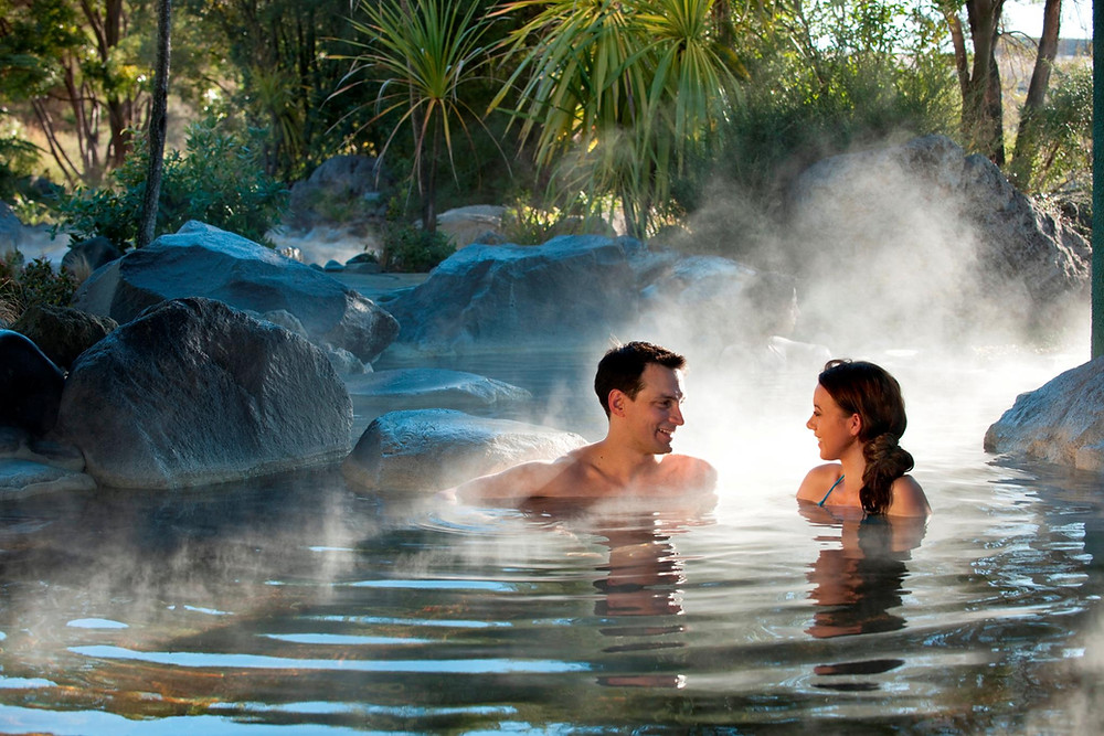 Two swimmers enjoy the Polynesian Spa