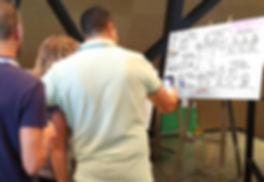 מצלמים את התמונה המאויירת שאייר בעז פיין מתוך ההרצאה בכנס