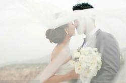 bride and groom kiss romance
