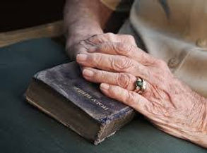 elderly-hands-on-bible_1_orig.jpg