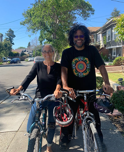 An image of the author, Raquel Pinderhughes, and her husband Howard on bicycles