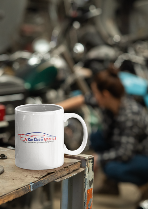 mockup-of-a-coffee-mug-at-a-mechanic-gar